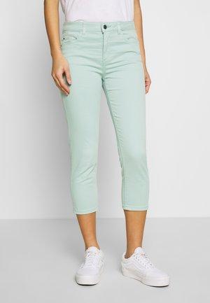 CAPRI - Slim fit jeans - light aqua green