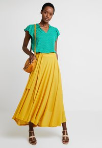 Esprit - FLARED - Maxi skirt - brass yellow