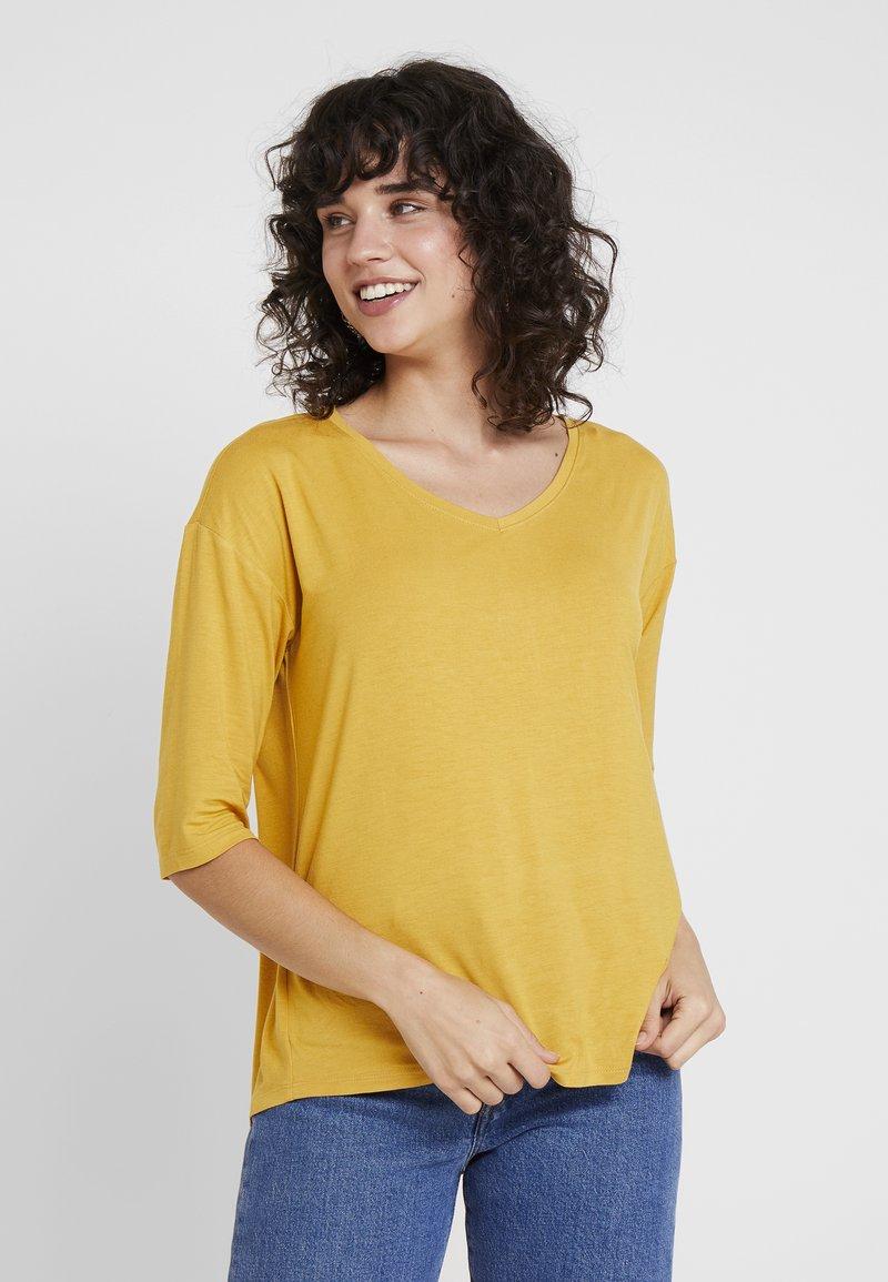Esprit - Langærmede T-shirts - honey yellow