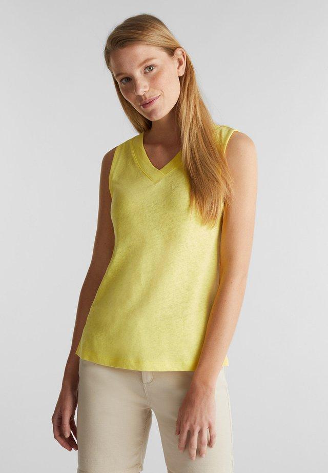 Top - bright yellow
