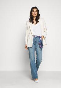 Esprit - Bootcut jeans - blue medium wash - 1