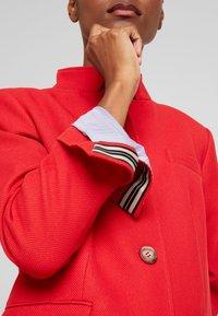 Esprit - PIQUET - Halflange jas - dark red - 8
