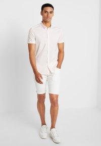 Esprit - MICRO - Jeans Shorts - white - 1