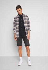 Esprit - Denim shorts - black medium wash - 1