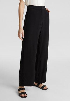 CRÊPE - Trousers - black