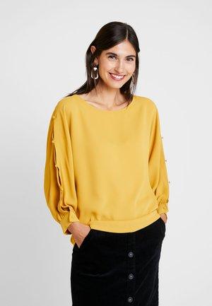 Blus - amber yellow