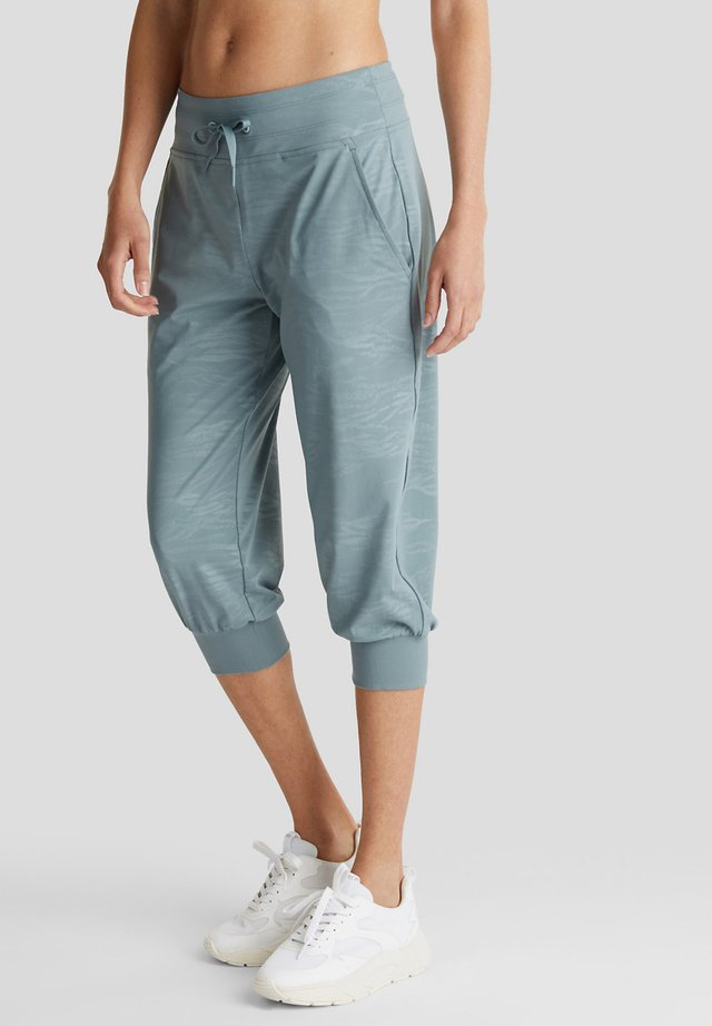 MIT PRINT, E-DRY - Tracksuit bottoms - dusty green
