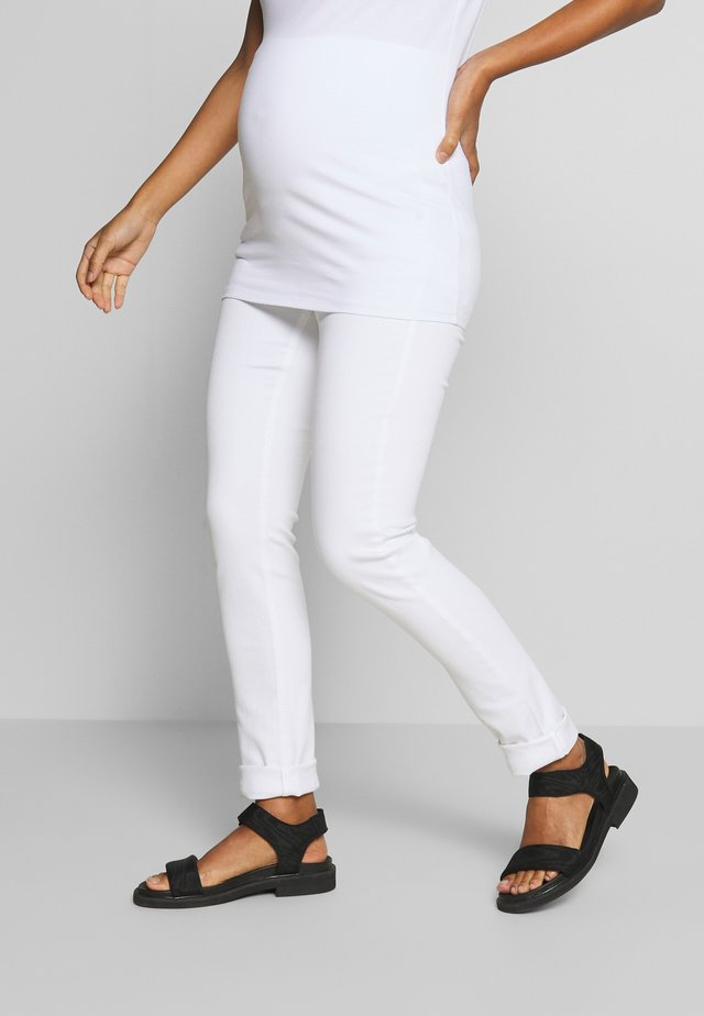 PANTS - Slim fit jeans - white