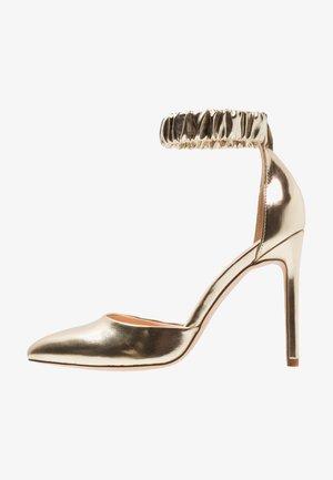 Zapatos altos - gold