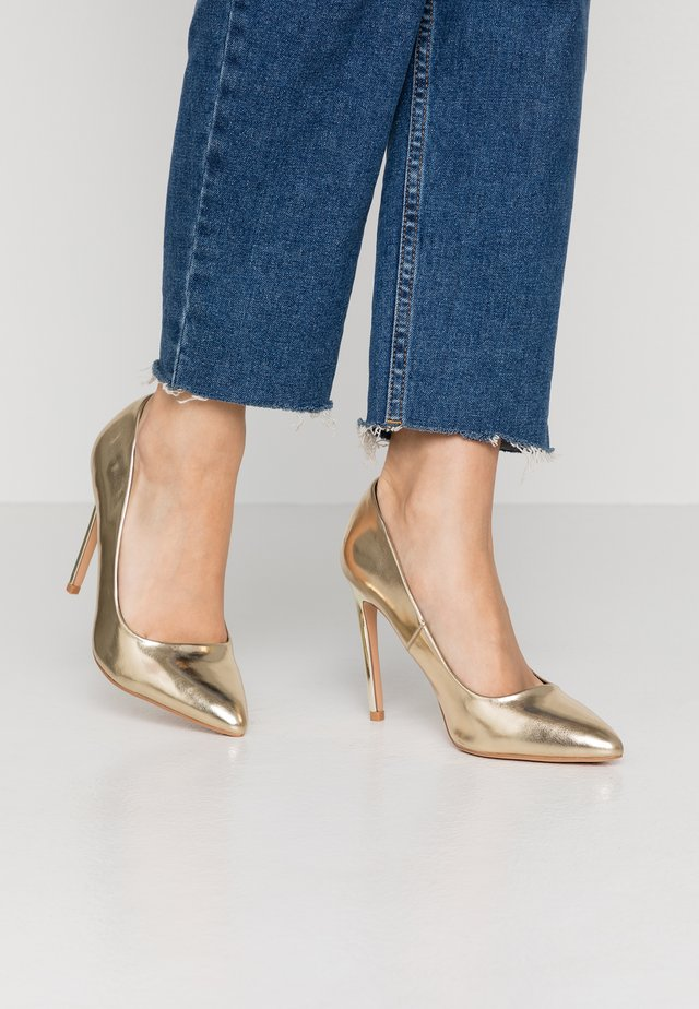 High Heel Pumps - gold