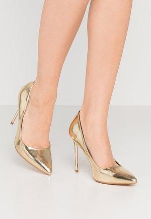 Escarpins à talons hauts - gold