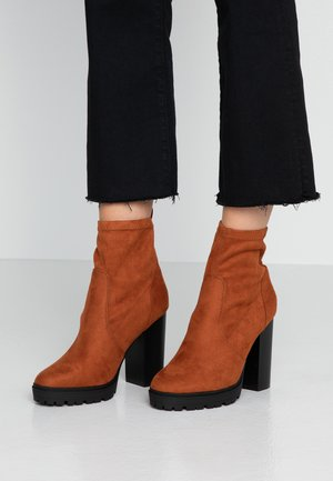 High heeled ankle boots - burnt orange