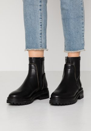LEATHER BOOTIE - Plateaustøvletter - black