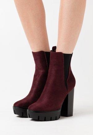Kotníková obuv na vysokém podpatku - burgundy