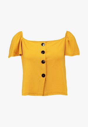T-shirt con stampa - mustard