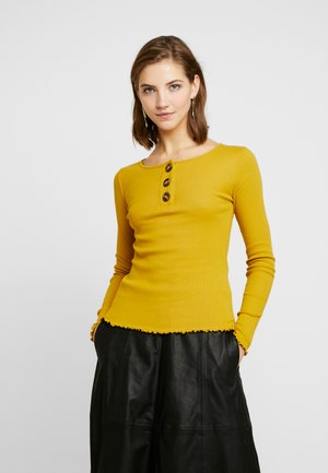 Long sleeved top - lemon curry