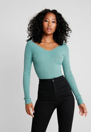 Stickad tröja - turquoise