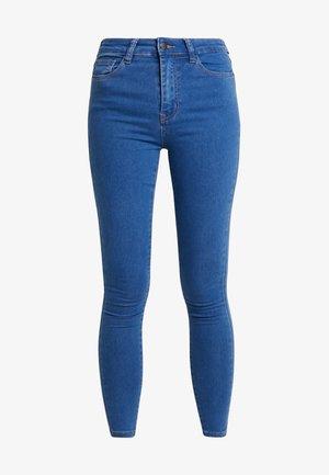 Skinny džíny - mid blue denim