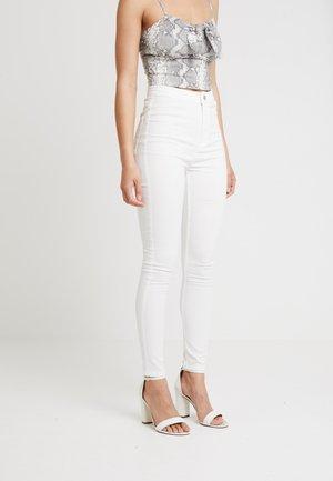 Skinny džíny - white denim