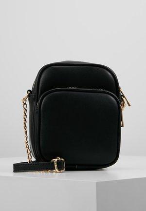 Bandolera - black