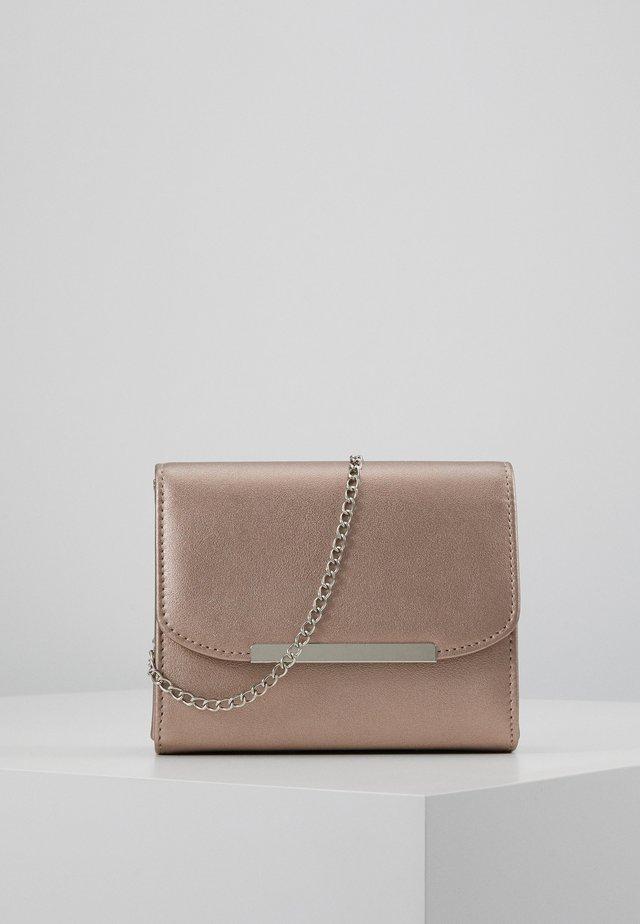 Across body bag - rose gold