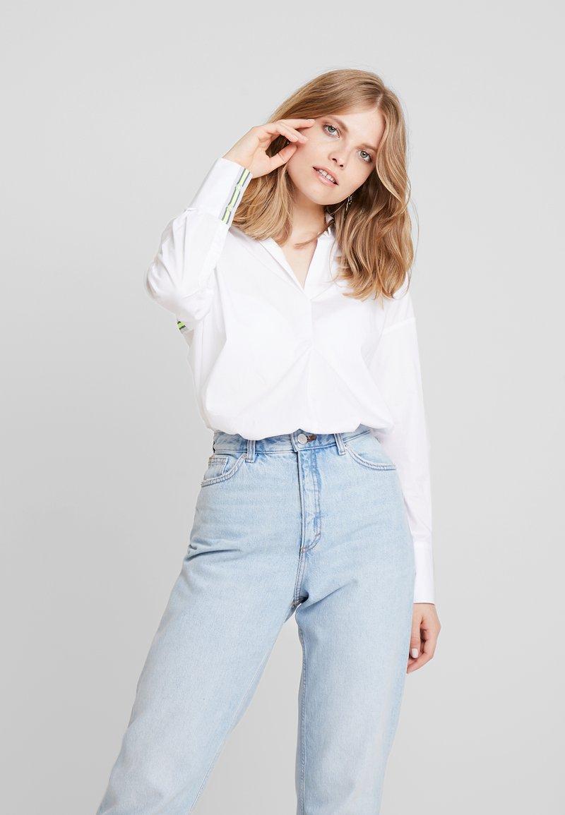 Emily van den Bergh - Button-down blouse - white