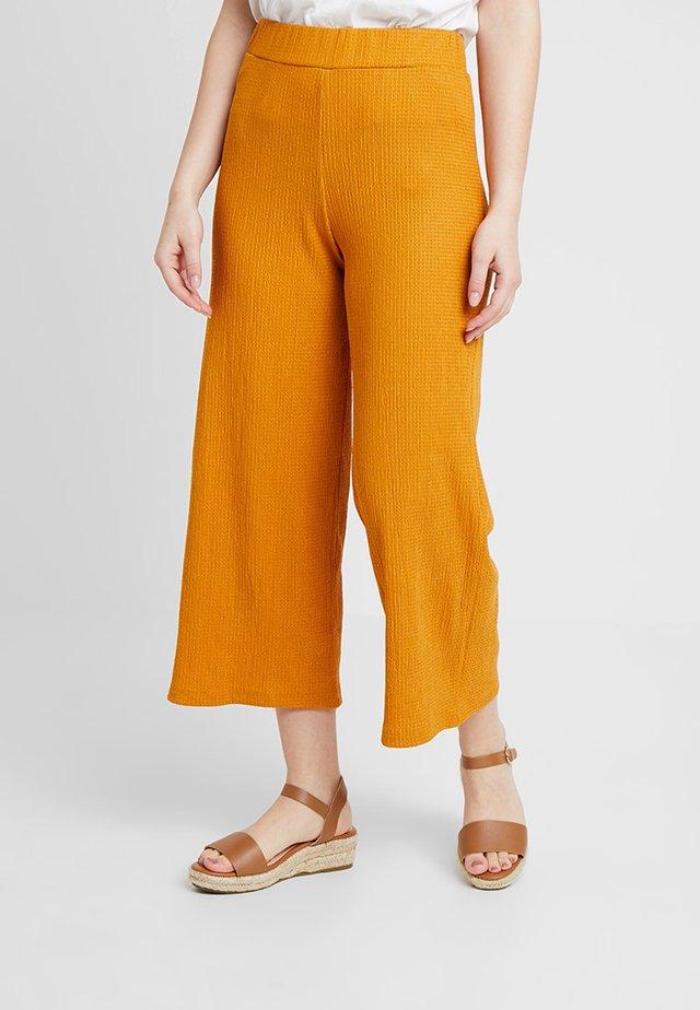 Tygbyxor - yellow