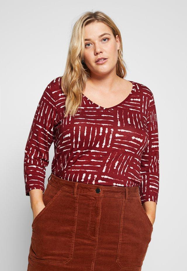 Long sleeved top - rust