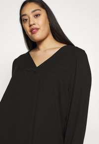 Evans - CROSS FRONT - Tunique - black