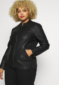 Evans - STITCH DETAIL BIKER JACKET - Faux leather jacket - black - 3