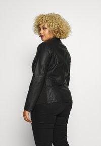 Evans - STITCH DETAIL BIKER JACKET - Faux leather jacket - black - 2