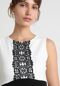 Anna Field MAMA - DRESS WITH FLARED - Jerseyjurk - black/off-white - 4
