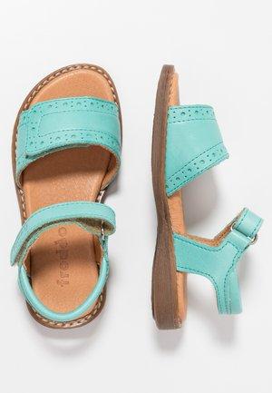 Sandaalit nilkkaremmillä - light green