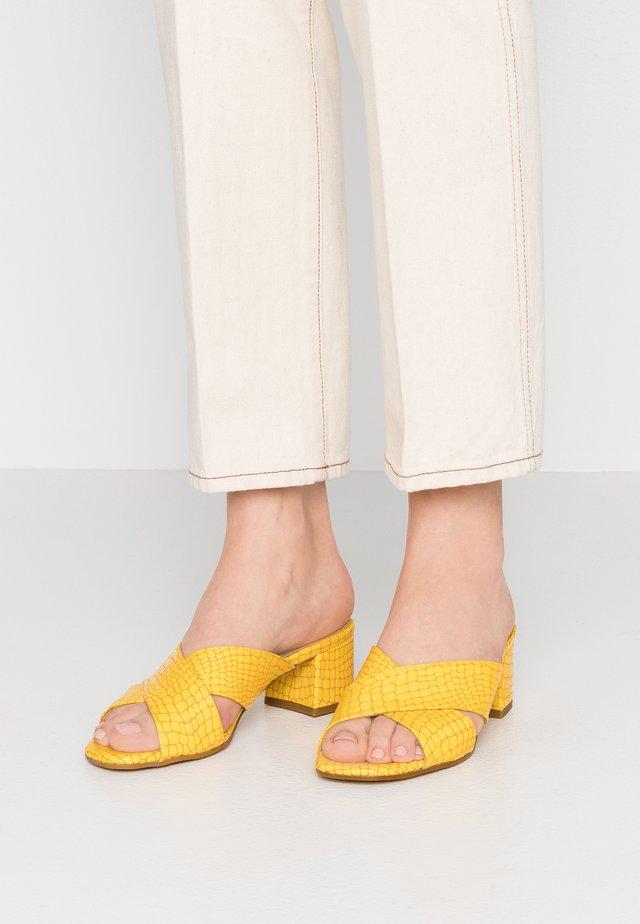 VENETIA - Heeled mules - giallo