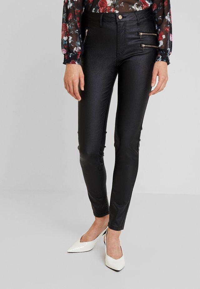 AIDA COOPER - Trousers - black