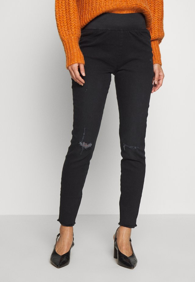 SHANTAL - Slim fit jeans - black