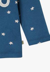Frugi - BOBBY APPLIQUE BABY - Top sdlouhým rukávem - steely blue star - 3