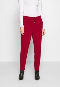 Filippa K - FIONA PEG - Trousers - pure red - 0