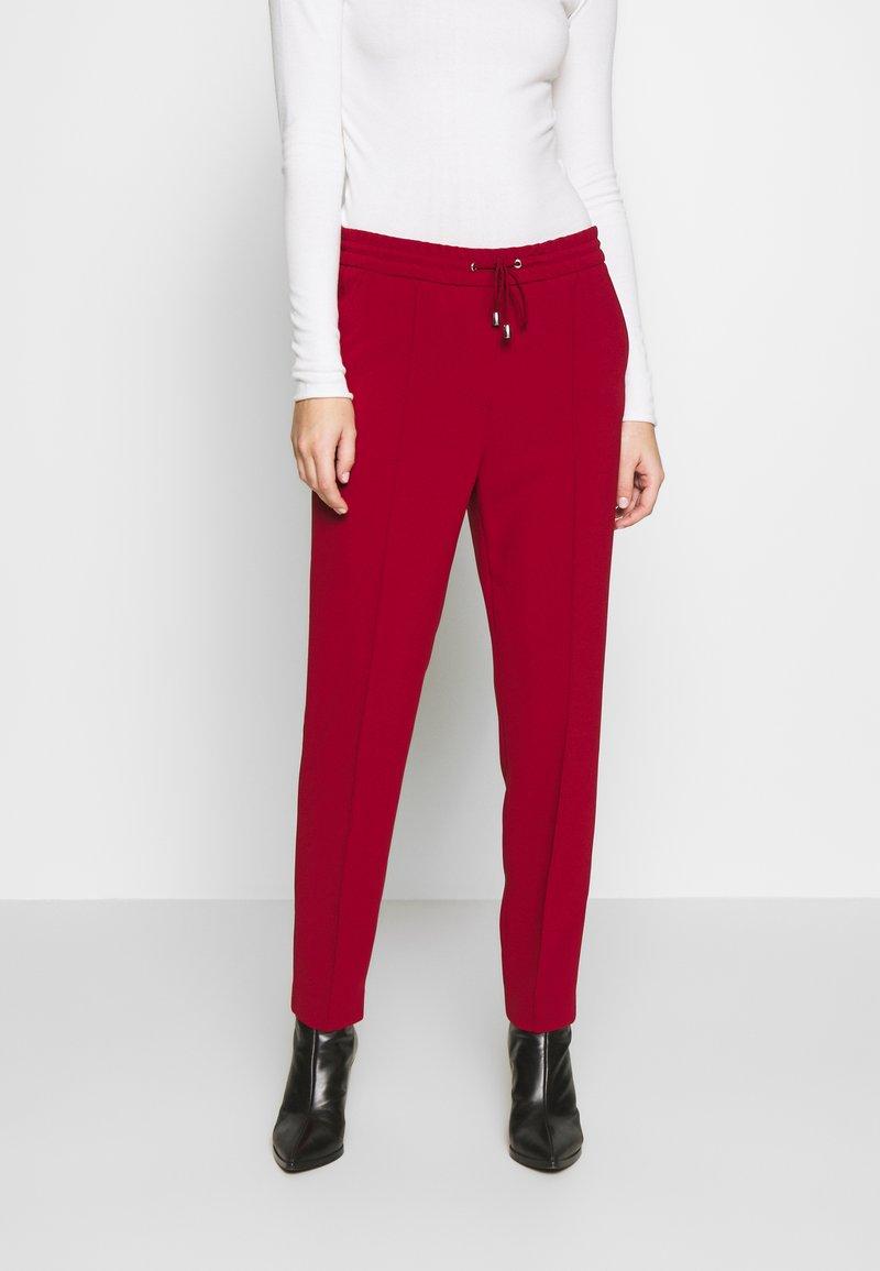 Filippa K - FIONA PEG - Trousers - pure red