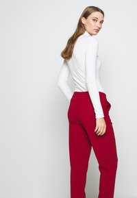 Filippa K - FIONA PEG - Trousers - pure red - 3