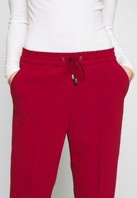 Filippa K - FIONA PEG - Trousers - pure red - 5