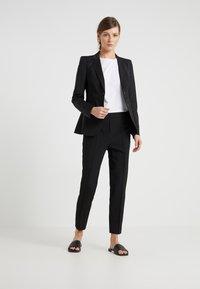 Filippa K - FIONA PEG - Trousers - black - 1