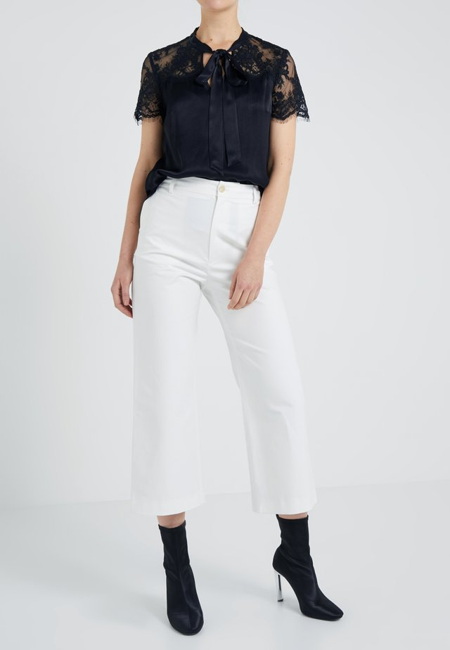 LAURIE TROUSERS - Tygbyxor - white