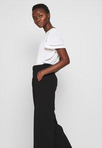 Filippa K - NAIA TROUSER - Trousers - black - 3