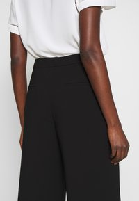 Filippa K - NAIA TROUSER - Trousers - black - 6