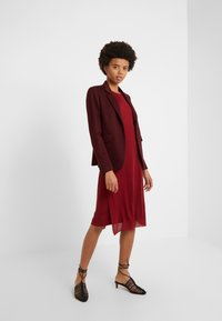 Filippa K - Gebreide jurk - pure red - 1