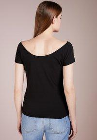Filippa K - BALLERINA STYLE CAP SLEEVE - T-shirt basique - black - 2