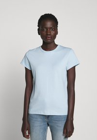 Filippa K - FLARED CAP SLEEVE - T-shirt basic - pale blue - 0