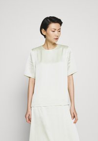 Filippa K - ANGELA TEE - Blusa - pale lime - 0