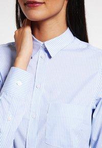 Filippa K - CLASSIC - Button-down blouse - light blue stripe - 3